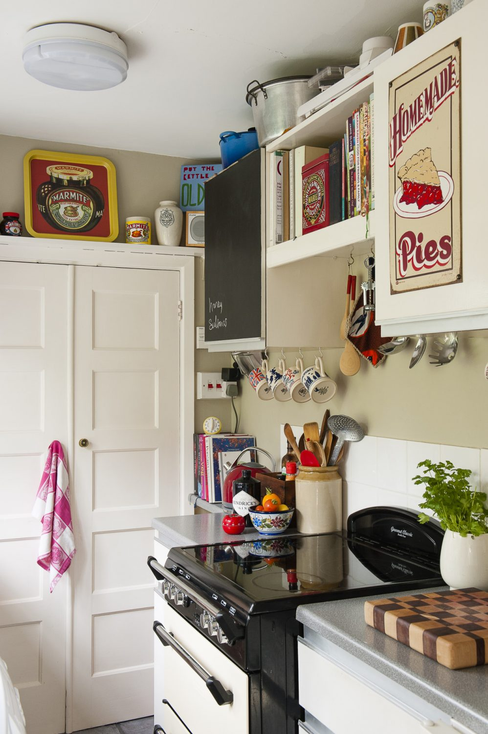 A galley kitchen continues in the retro theme