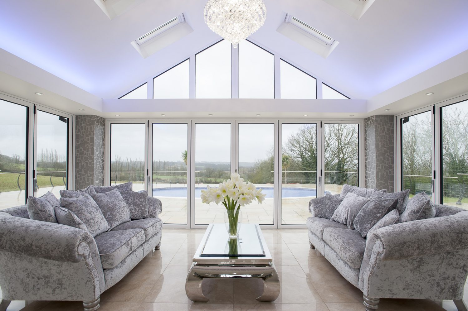 Bi-folding doors in the orangery lead out onto the terrace and its oval-shaped pool