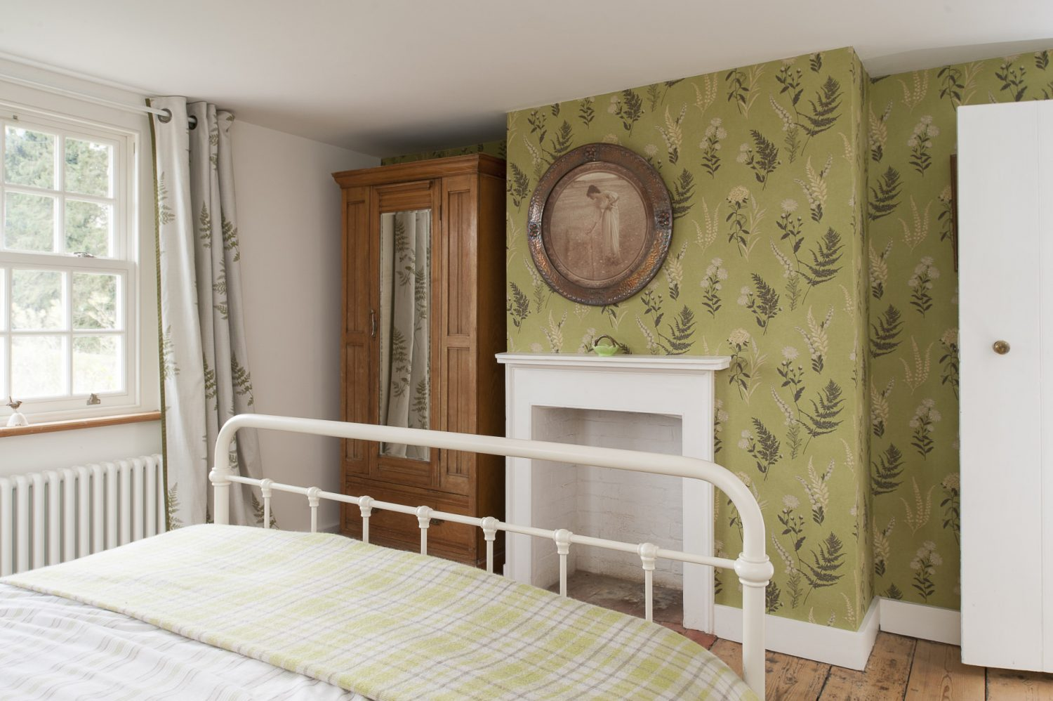 Jen fell in love with Fired Earth's wallpaper 'After Eight' which she has used on the feature wall and chimney breast at the foot of the bed
