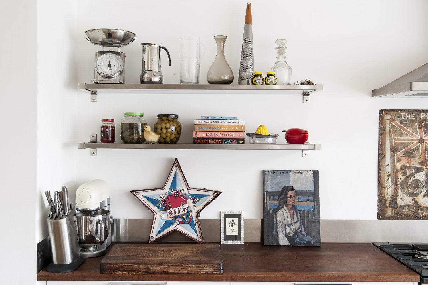 Open shelving is practical – as well as displaying the couple's collection of kitchenware, cookbooks and artwork