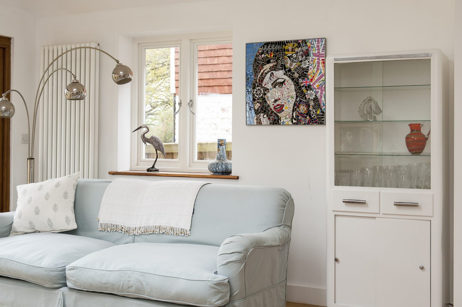 A mosaic made from fragments of crockery, called simply 'Amy' takes pride of place in the kitchen /living area