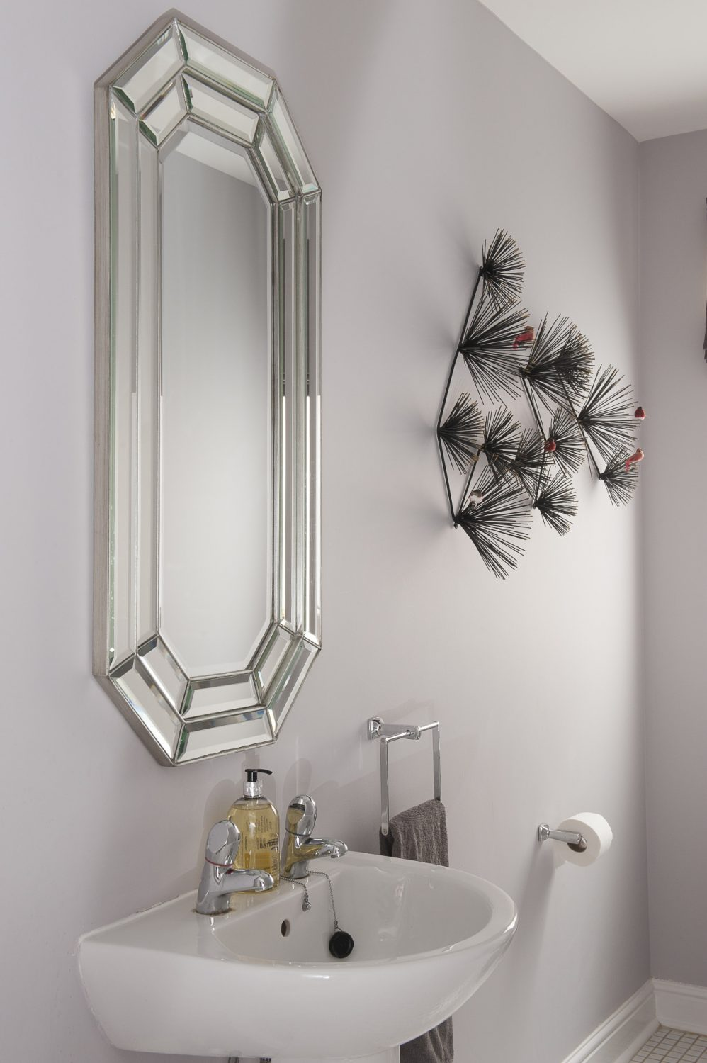 The downstairs loo features a wall scuplture that Phoebe found at HomeSense