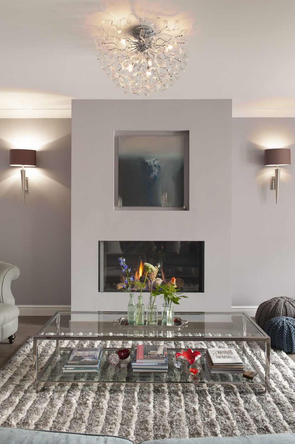 """""""There is usually a starting point. It can be a painting, like in my sitting room,"""" she says, indicating a striking piece by Emma Green above the fireplace"""
