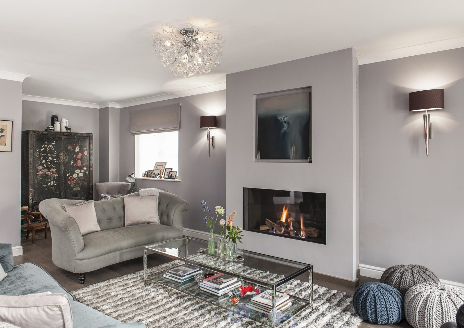 The starting point for the design of Phoebe's sitting room was the painting by artist Emma Green which is now mounted above the fireplace