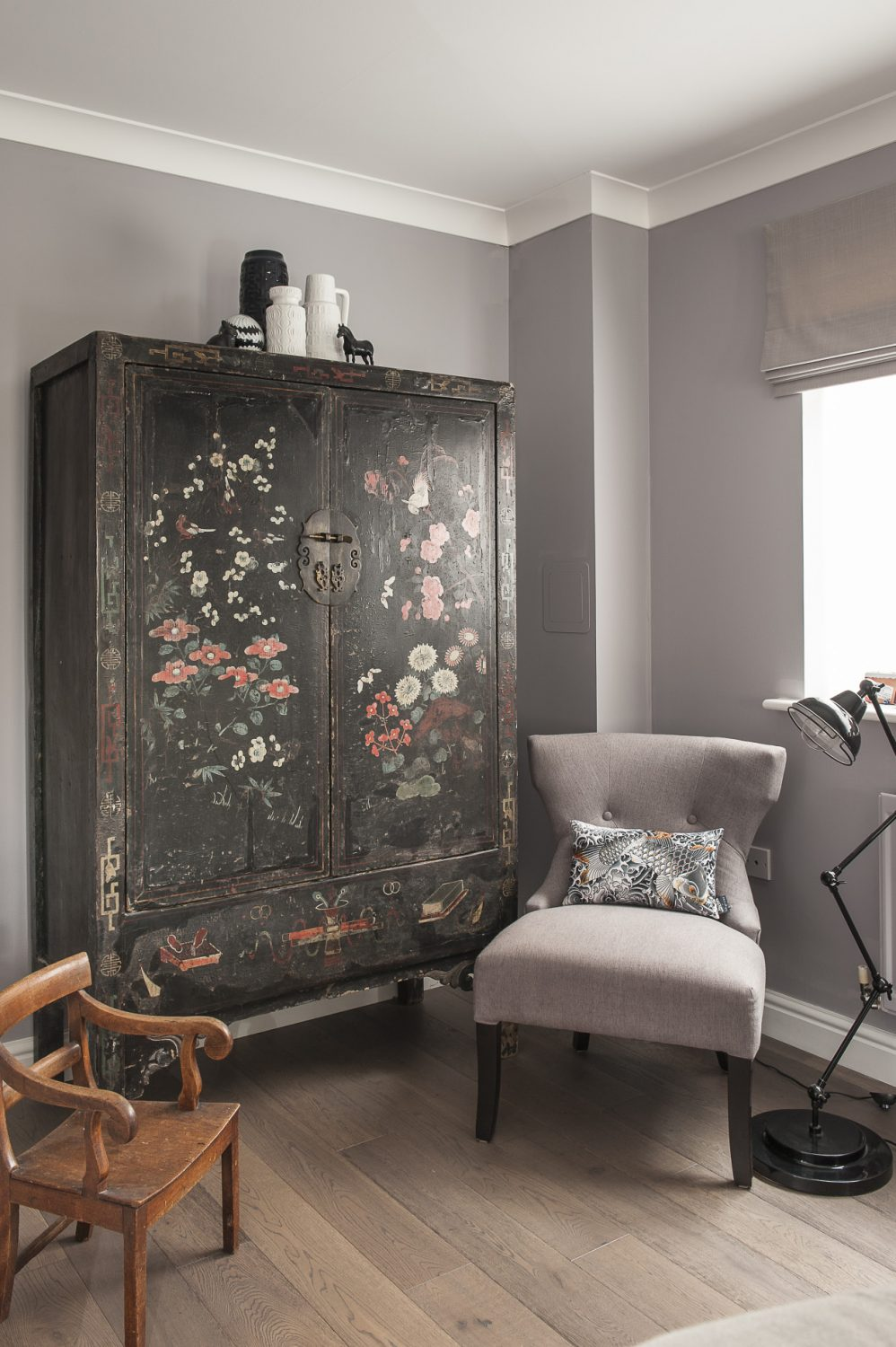 Phoebe has created a clever juxtaposition of textures, designs and patterns from inlaid chairs and an oriental cupboard to a sequinned Jean Paul Gaultier cushion