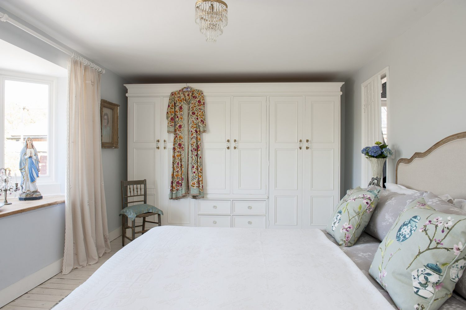 The main bedroom at the back of the cottage has wonderful views out over the garden to the fields beyond