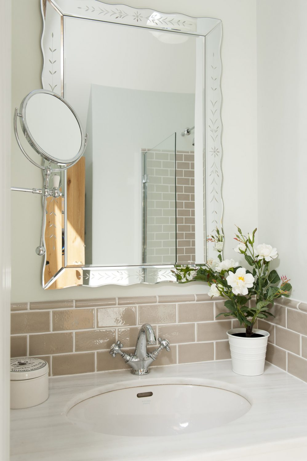 A pretty basin area in a compact washroom just off the landing