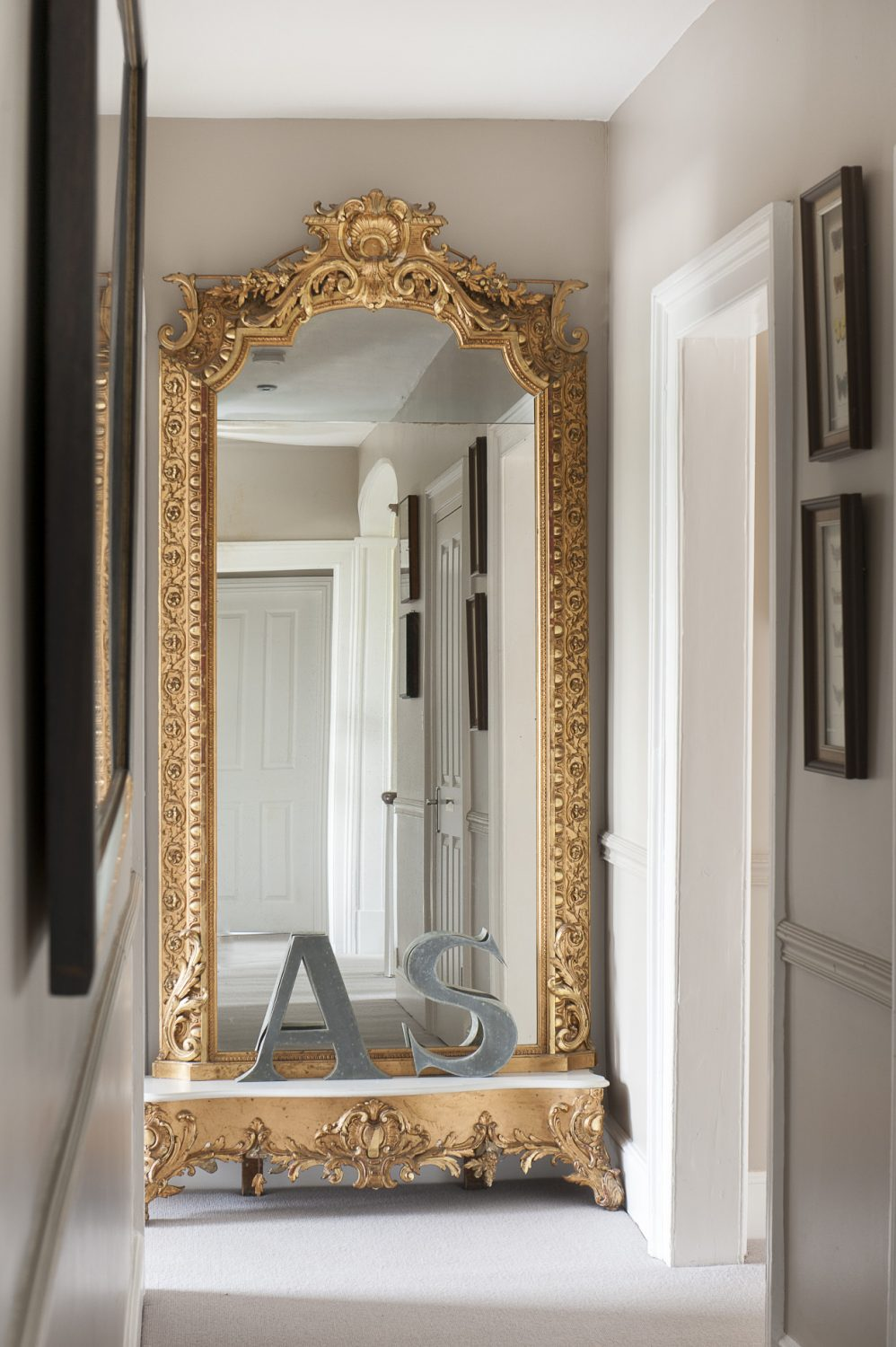 A huge, more-than-full-length mirror takes pride of place on the upstairs landing, reflecting the natural light which floods into the bedrooms through traditional sash windows