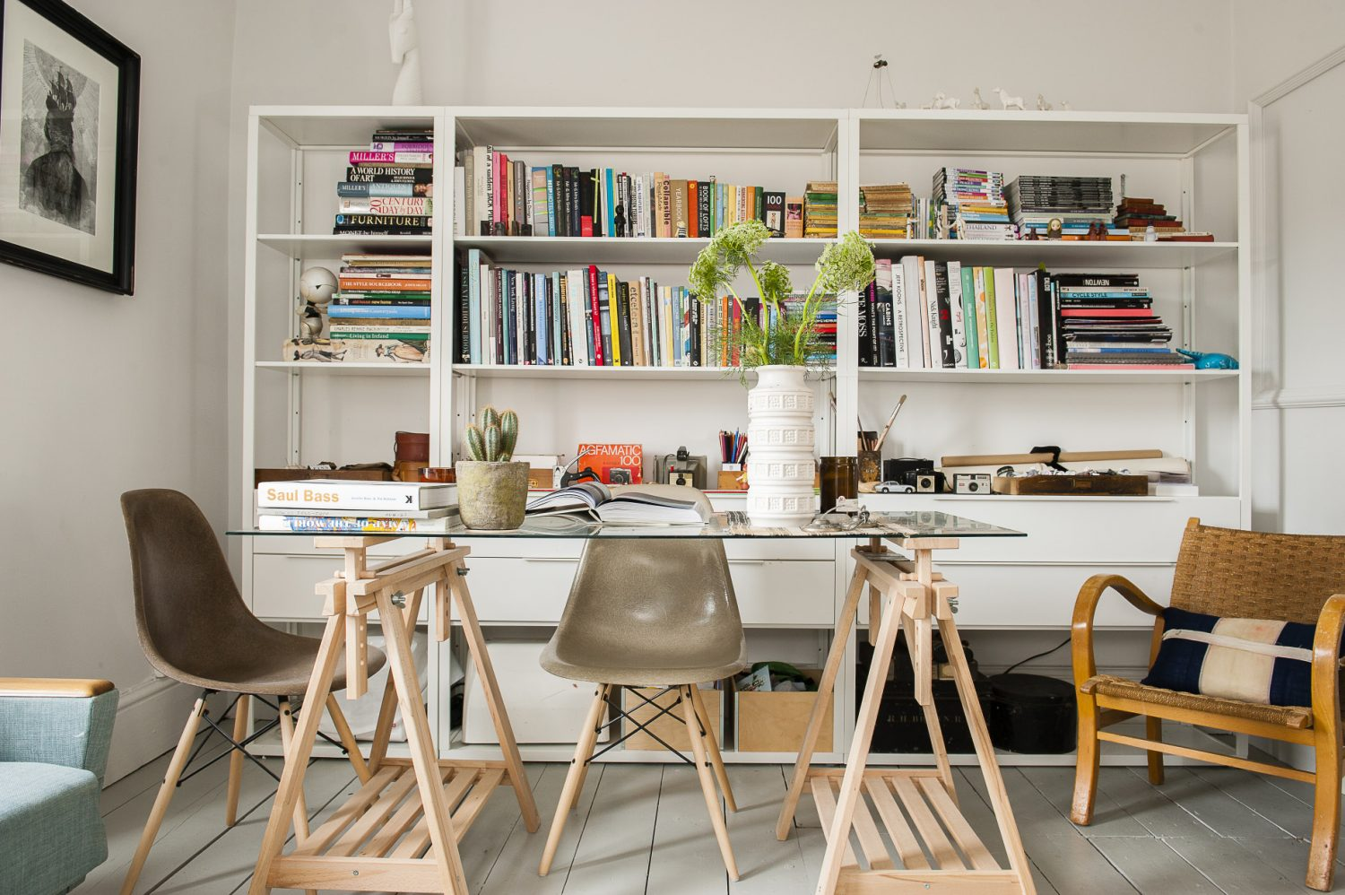 The bookcase and glass-topped desk