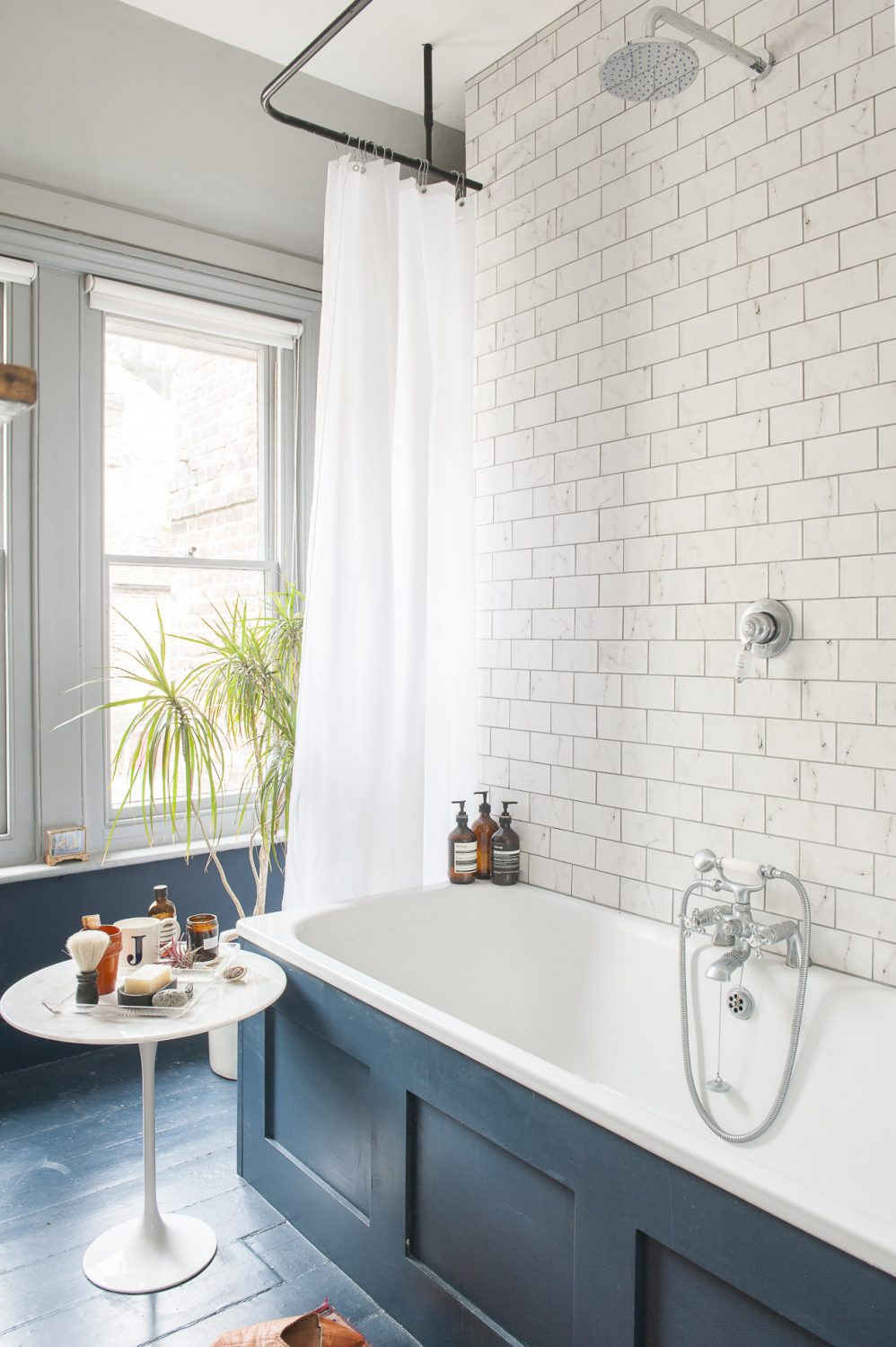 In the sparkling, 1930s-feel bathroom the floorboards are painted in the magnificent Hague Blue by Farrow & Ball.