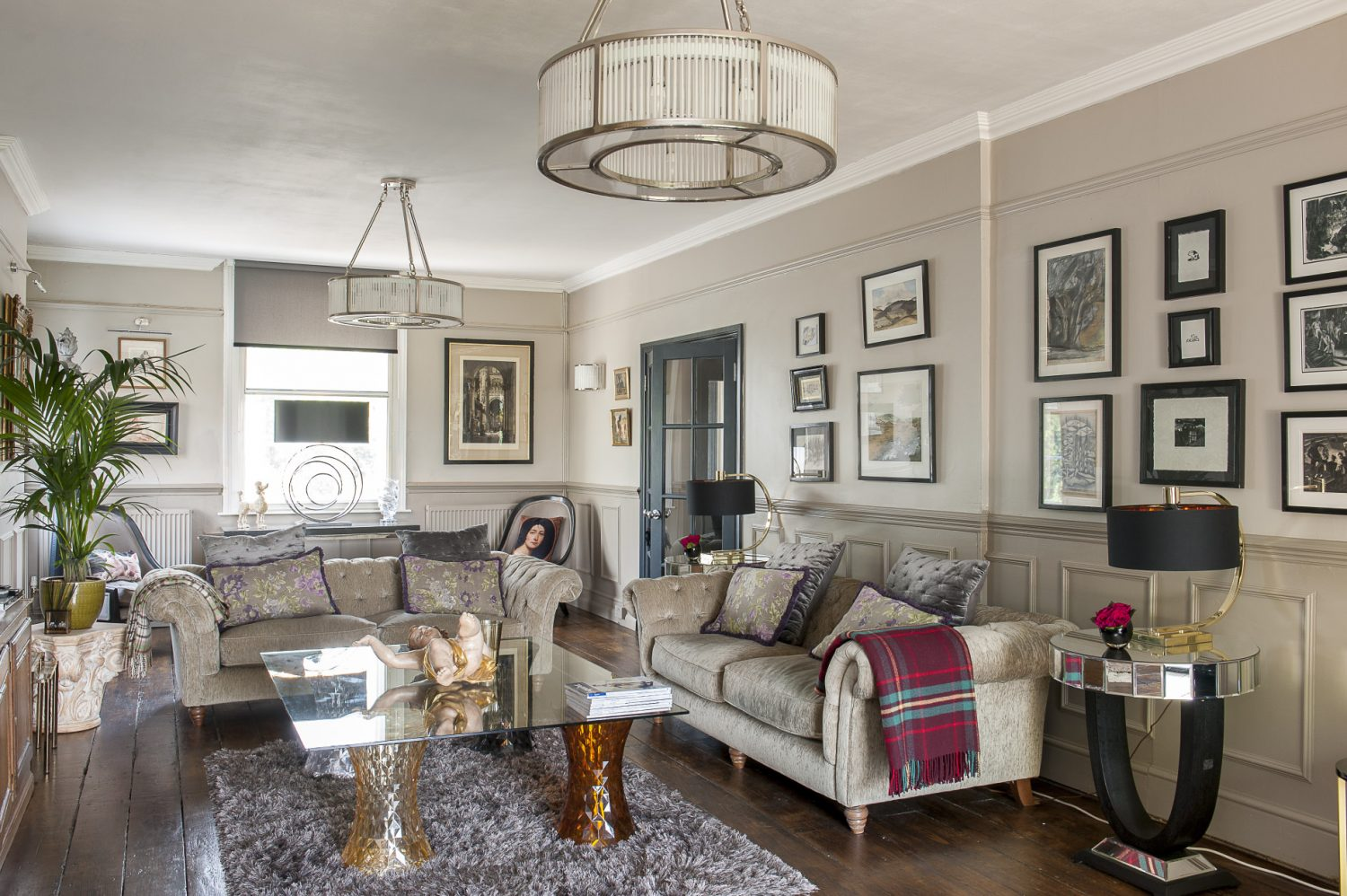 The drawing room contains matching French Deco wall and ceiling lights from WBR Interiors, a favourite shop on Wandsworth Bridge Road. Underneath is a coffee table constructed from a sheet of glass atop four Kartell Stone stools