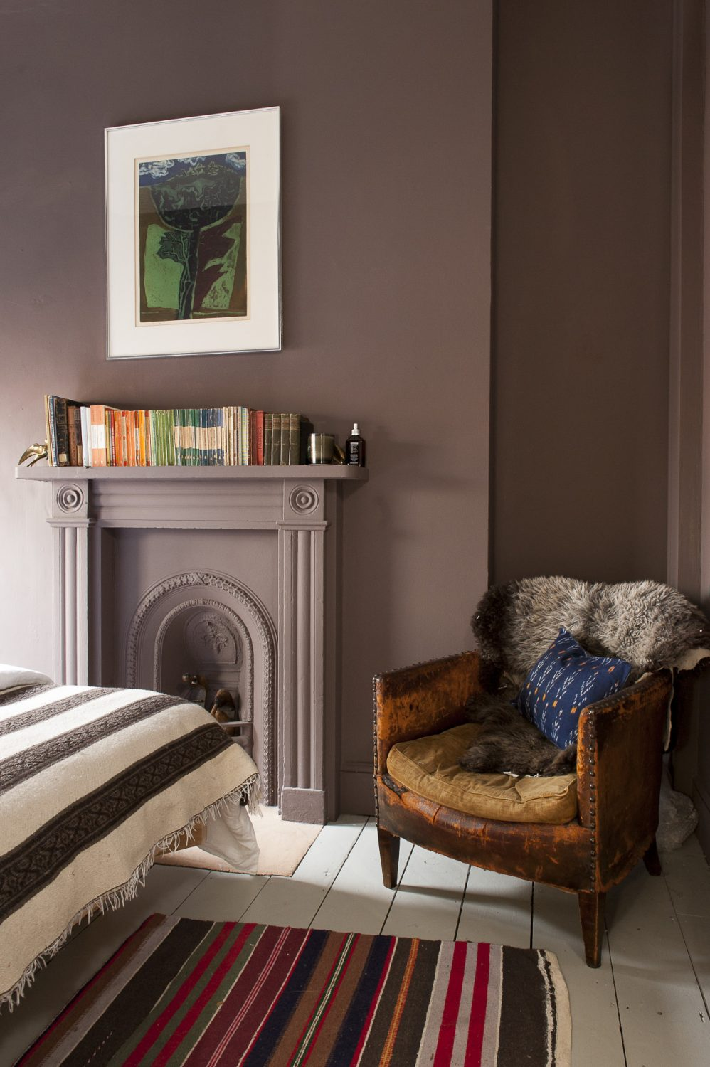 Classic novels sit on a the mantelpiece in the bedroom