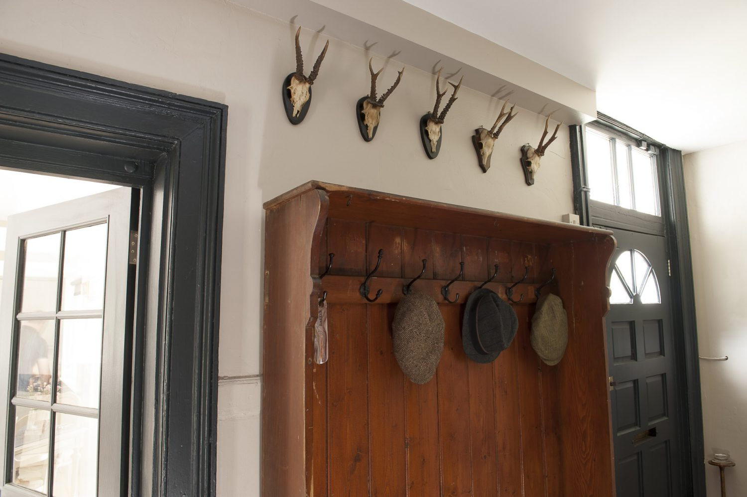 A collection of tweed flat caps adorn the pegs in the rear hallway – ready and waiting for a walk in the surrounding countryside. The couple are happy to arrange guided walks for visitors