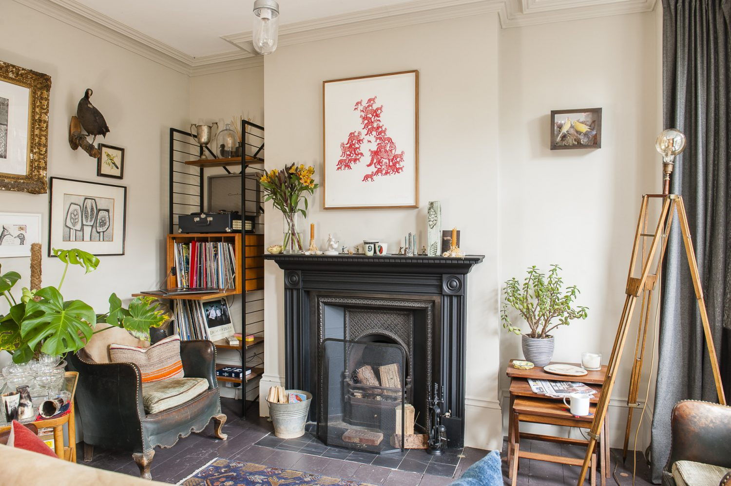 Above the fireplace in the living room hangs a UK map made out of foxes by artist Patrick Thomas. The ceramics on the mantelpiece are from The Clay Den in Hastings