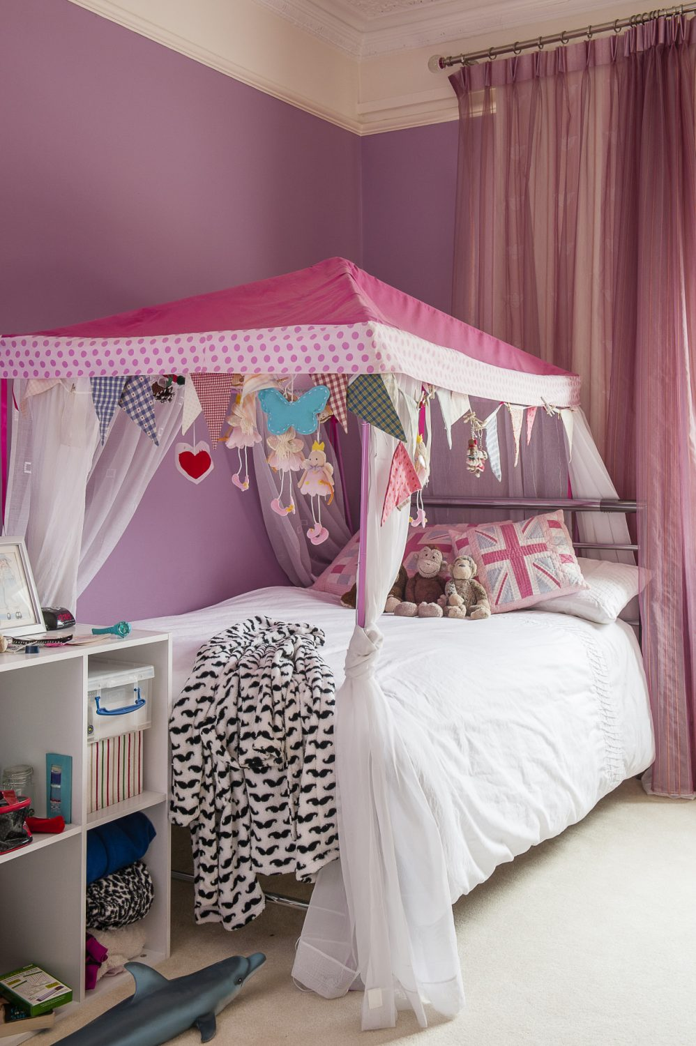 Daughter Katie's room is a paradise of pink and purple, complete with bunk beds to make it an ideal room for girly sleepovers