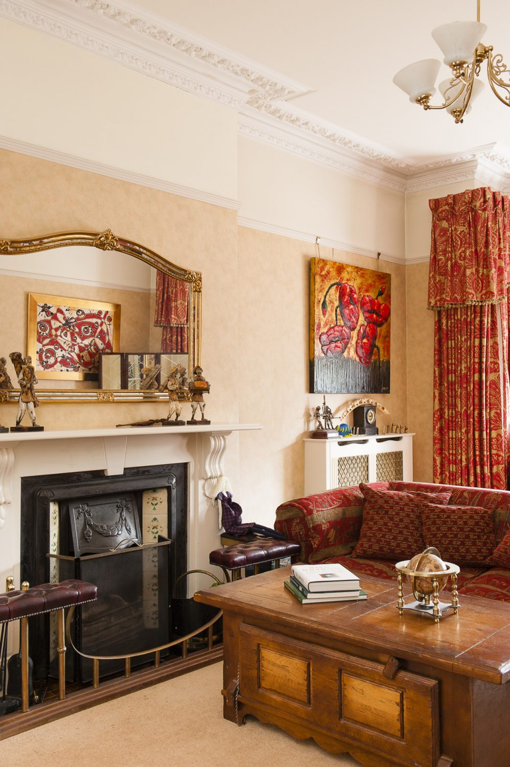Sofas gather around the fire in the family drawing room