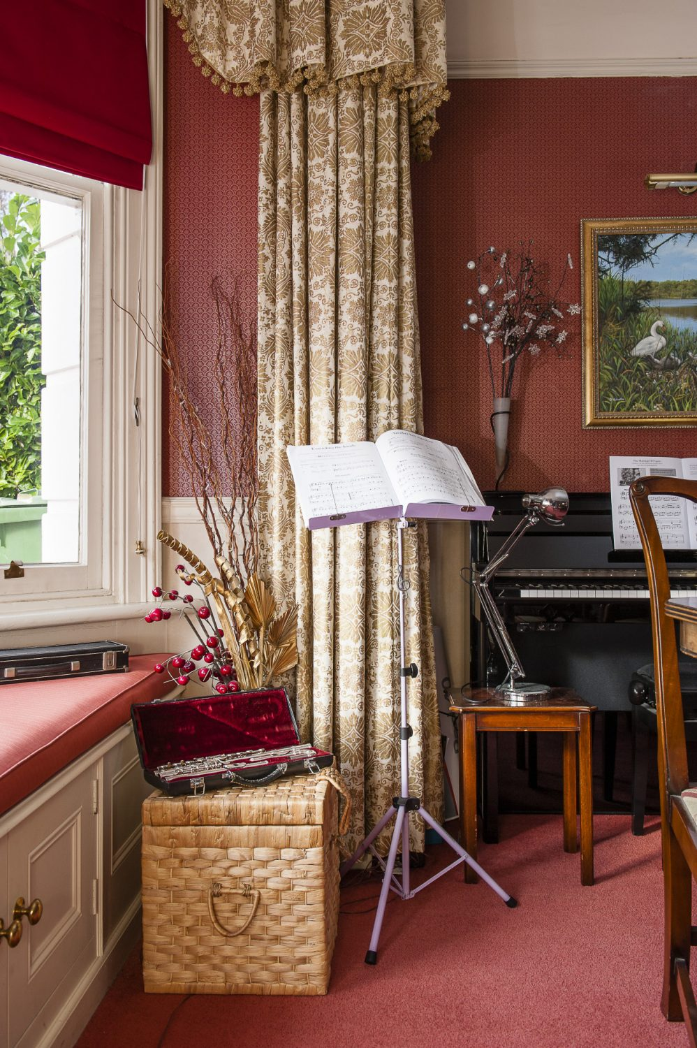 A piano and musical instruments nestle in one corner of the dining room