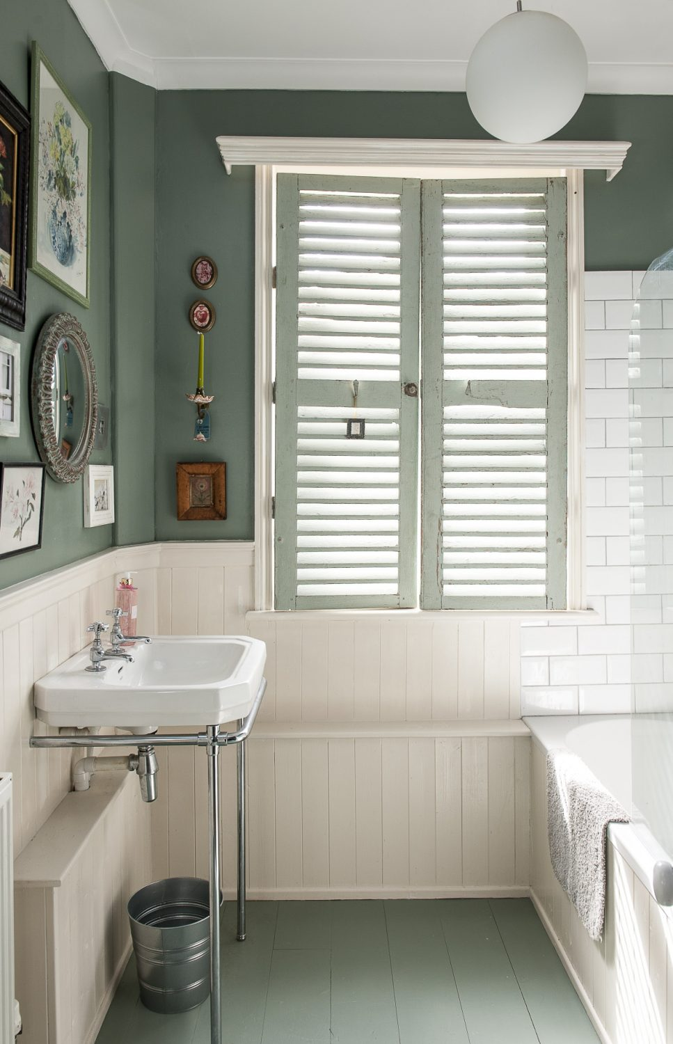 On the first floor, the family bathroom and loo are painted a mossy green and nautical blue, lined with off-white wood panelling