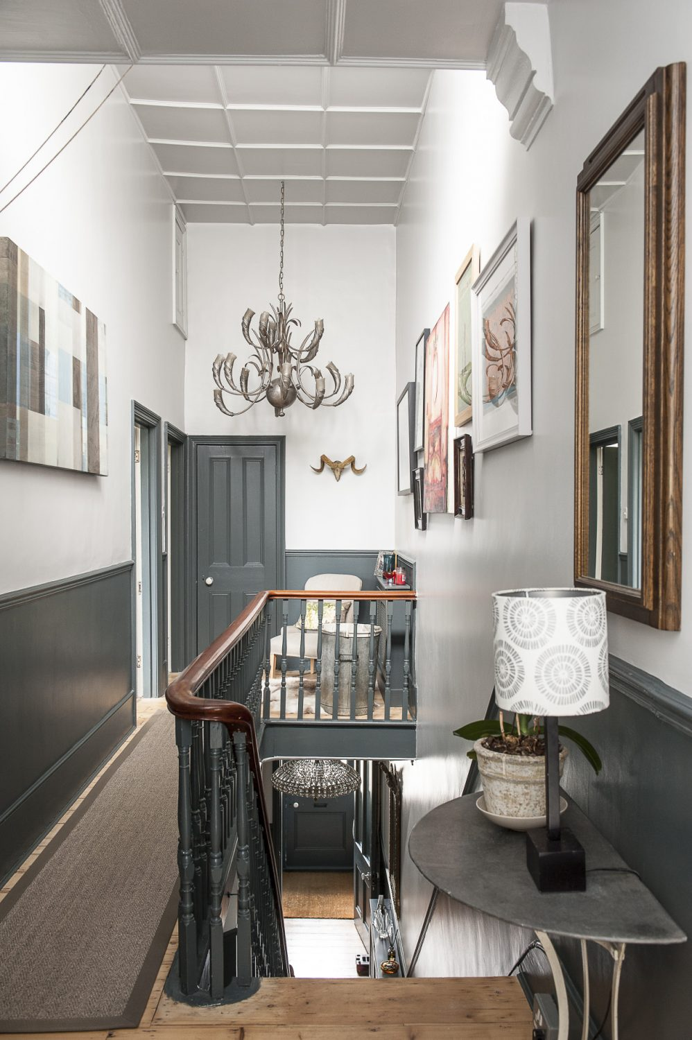 This was a large project, because the landing upstairs is huge. The walls above the stairs are very high, which also happily means that there's lots of space to hang pictures on the landing and plenty of room for some enormous, and enormously stylish, chandeliers