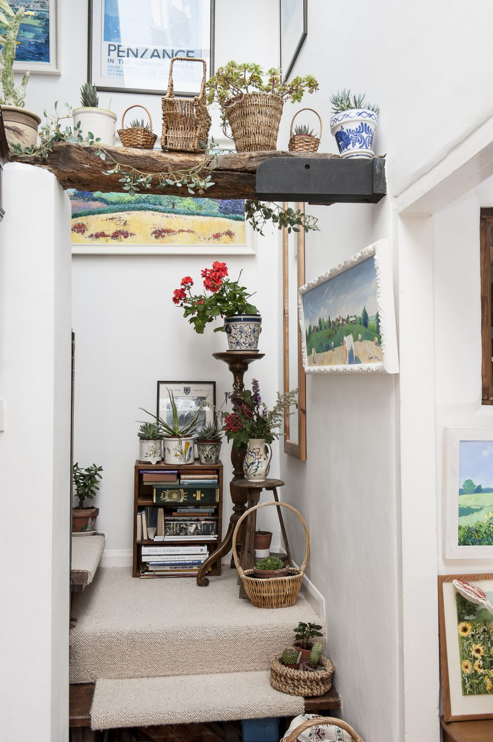 Suzanne has lined one of two staircases with baskets of succulents, cacti and geraniums