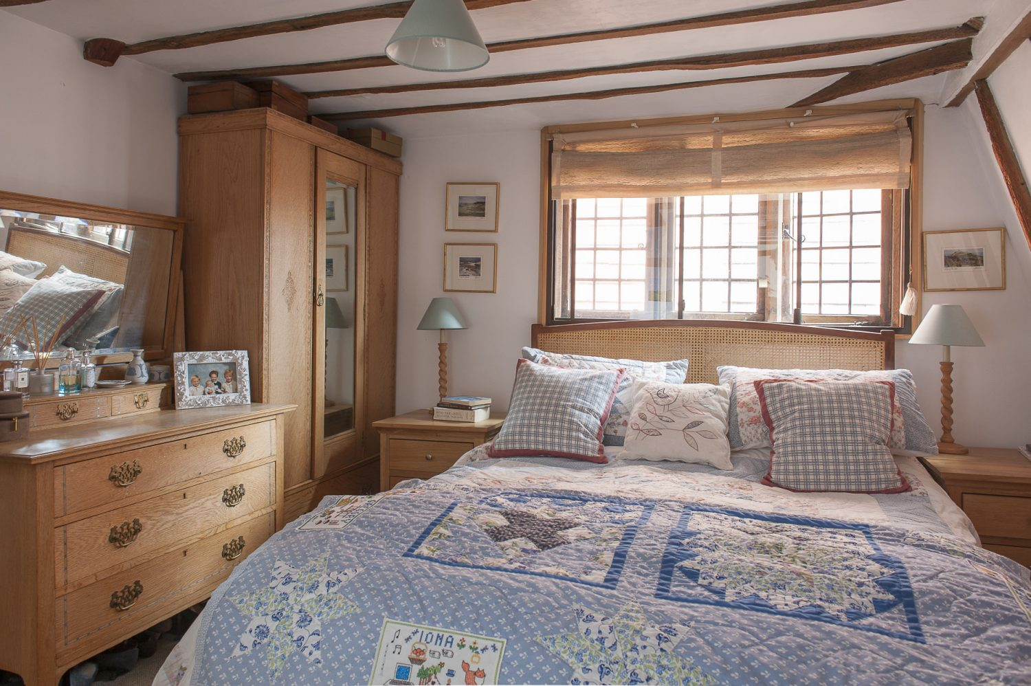 The master bedroom with its heirloom quilt made by Suzanne for her mother's 70th birthday
