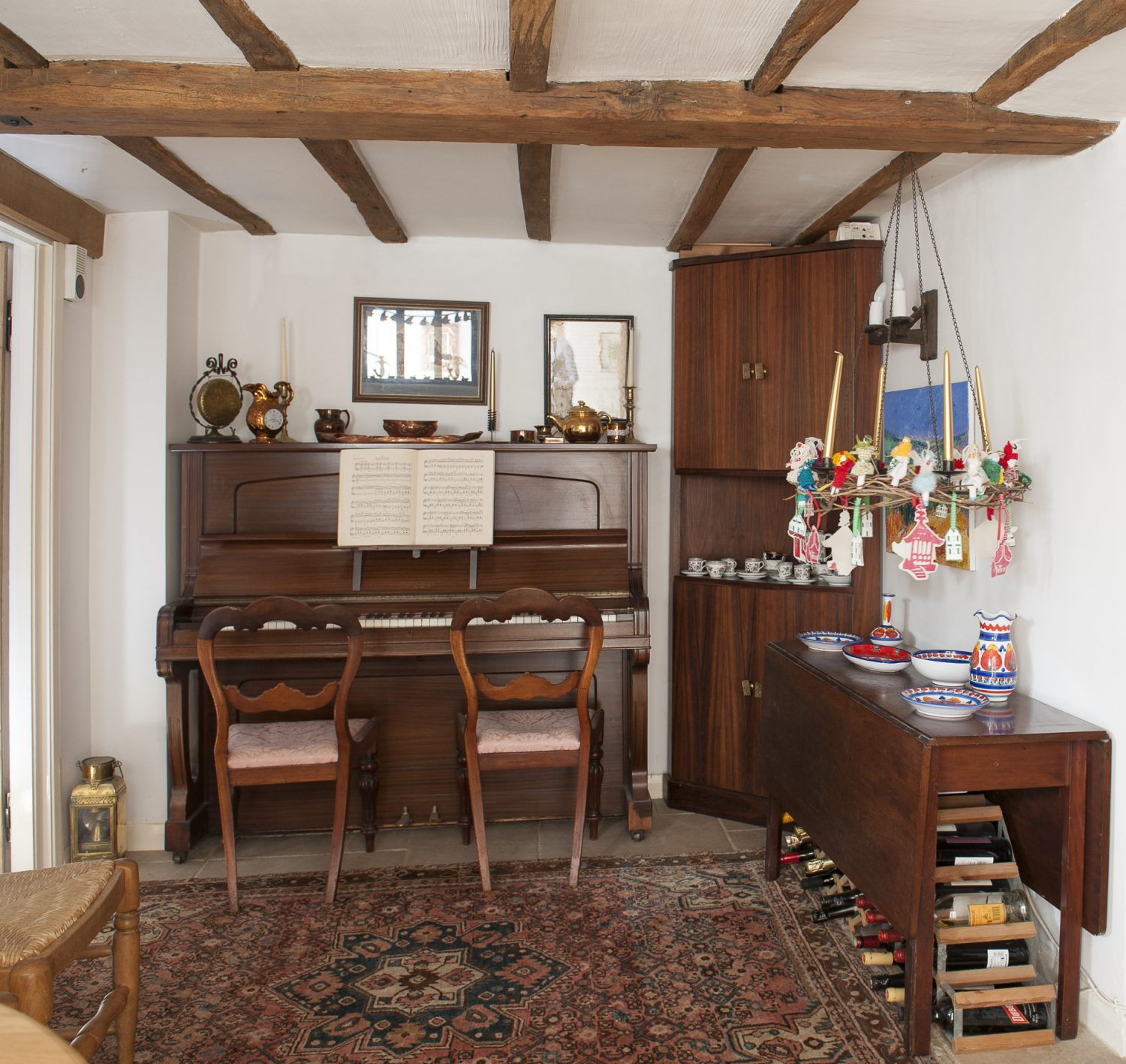 "Suzanne and her family had lived in their previous house for twenty-one years, so moving was quite a wrench for some members of the family. ""I hadn't realised quite how much it meant to my son Alexander especially to leave the old house – but he does like the fact that there's room for two pianos here. And we're so close to the church where Alexander regularly plays the organ,"" she says"