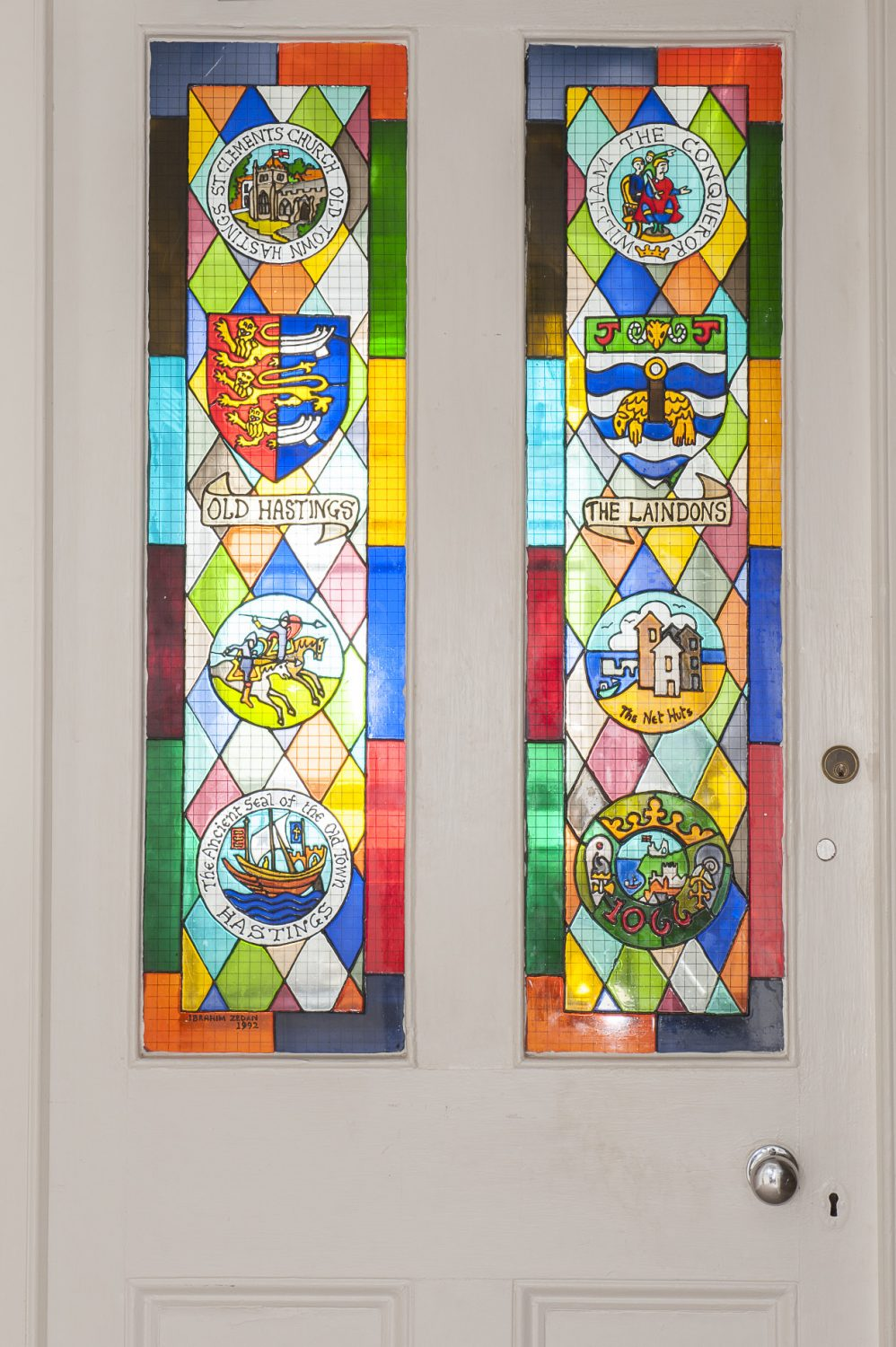 Personalised stained glass panels provide a powerful pop of colour in the corridor that separates the bedrooms from the drawing room and dining area