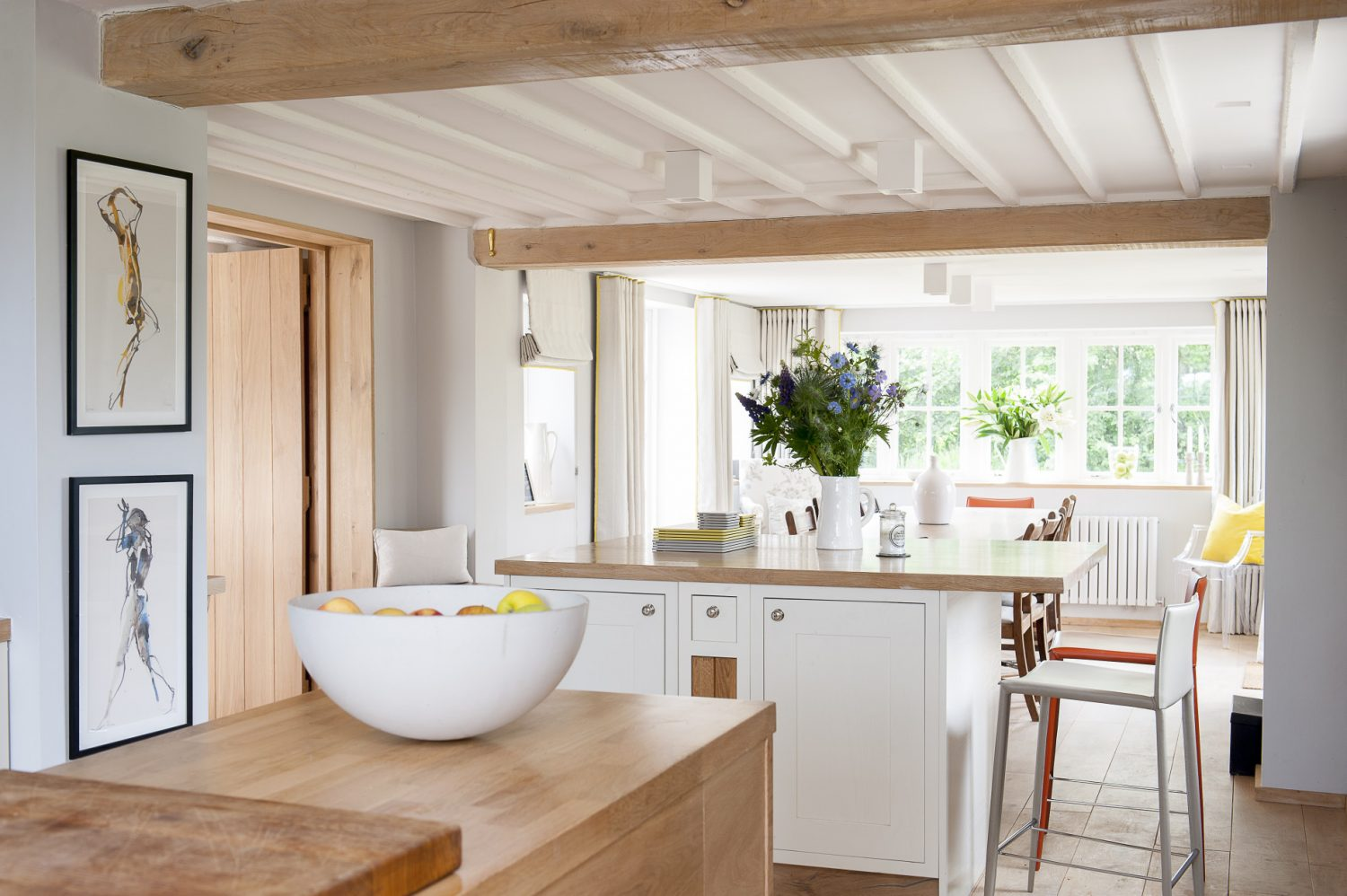 The couple built a two-storey extension, which has created a spacious open-plan kitchen and triple-aspect dining area with French doors into the garden