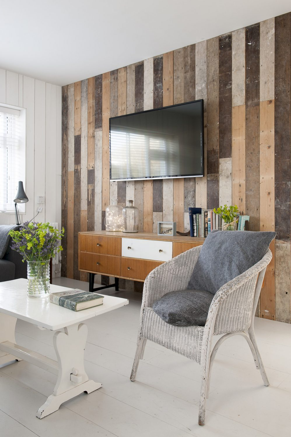 Nicola wanted each room in the house to feature one wall clad in reclaimed floorboards