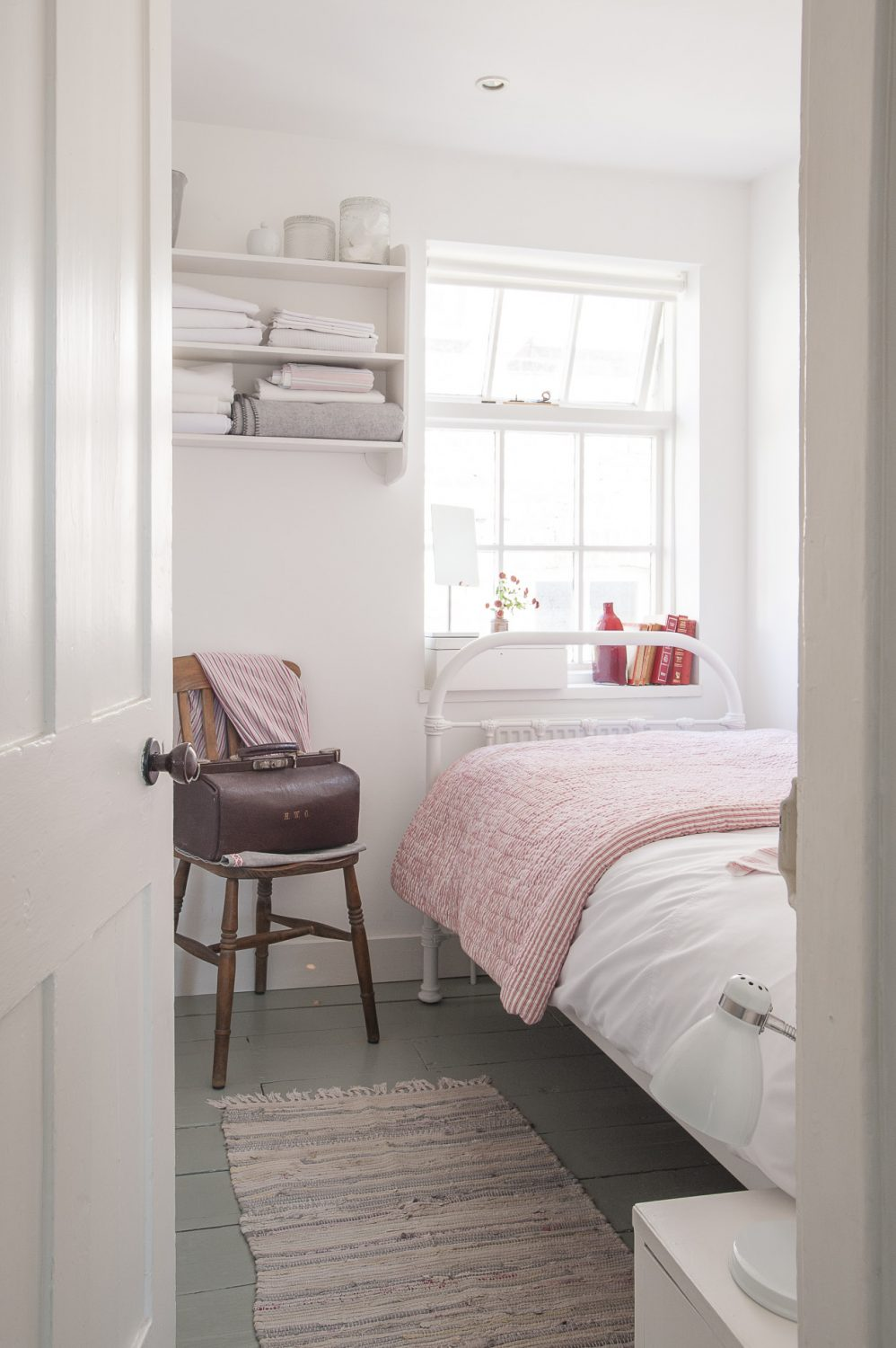 Both bedrooms feature welcoming Victorian-style 'iron' bedsteads. In the larger room there is even space for a modestly sized dressing room