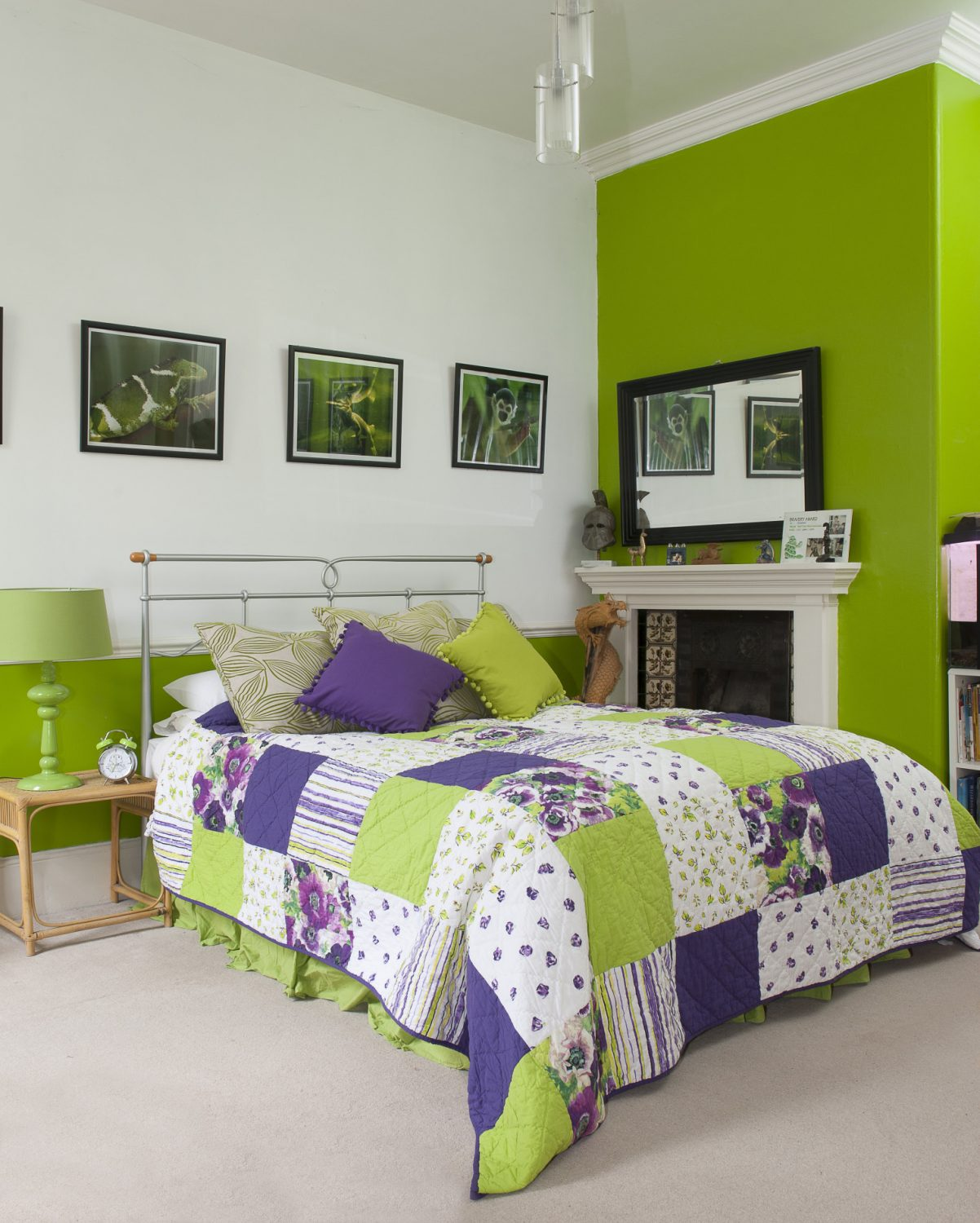 The lime green walls in Dawn's eldest son's room are perfectly complemented with a purple Ragged Rose patchwork quilt and pom-pom edged cushions