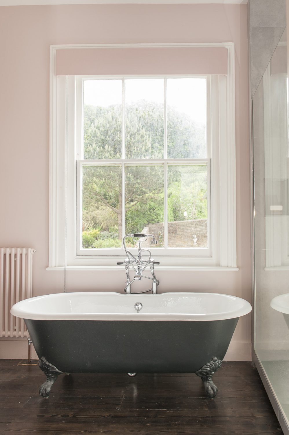 There is an equally lovely view from the bath - over a planted sedum flat roof and their neighbour's beautiful garden, up to Hastings Country Park. The bathroom fittings are from CP Hart