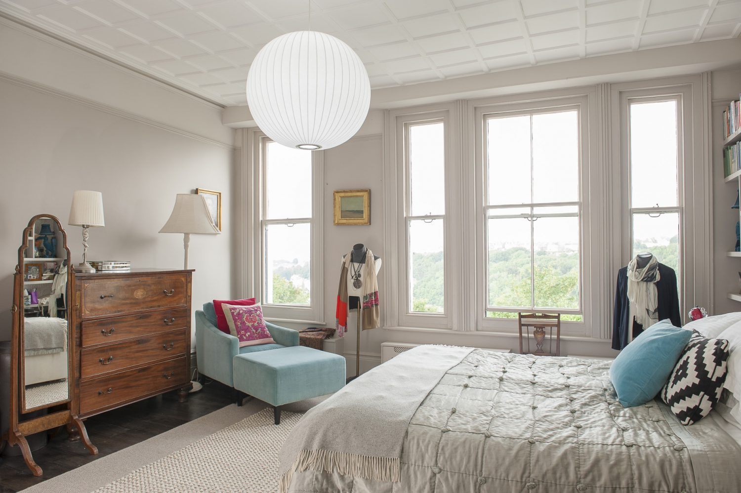 The master bedroom has magnificent views over Hastings Old Town and the sea, all the way to Beachy Head. The chaise longue is from Graham & Green and the mannequin was another find at Retrouvius