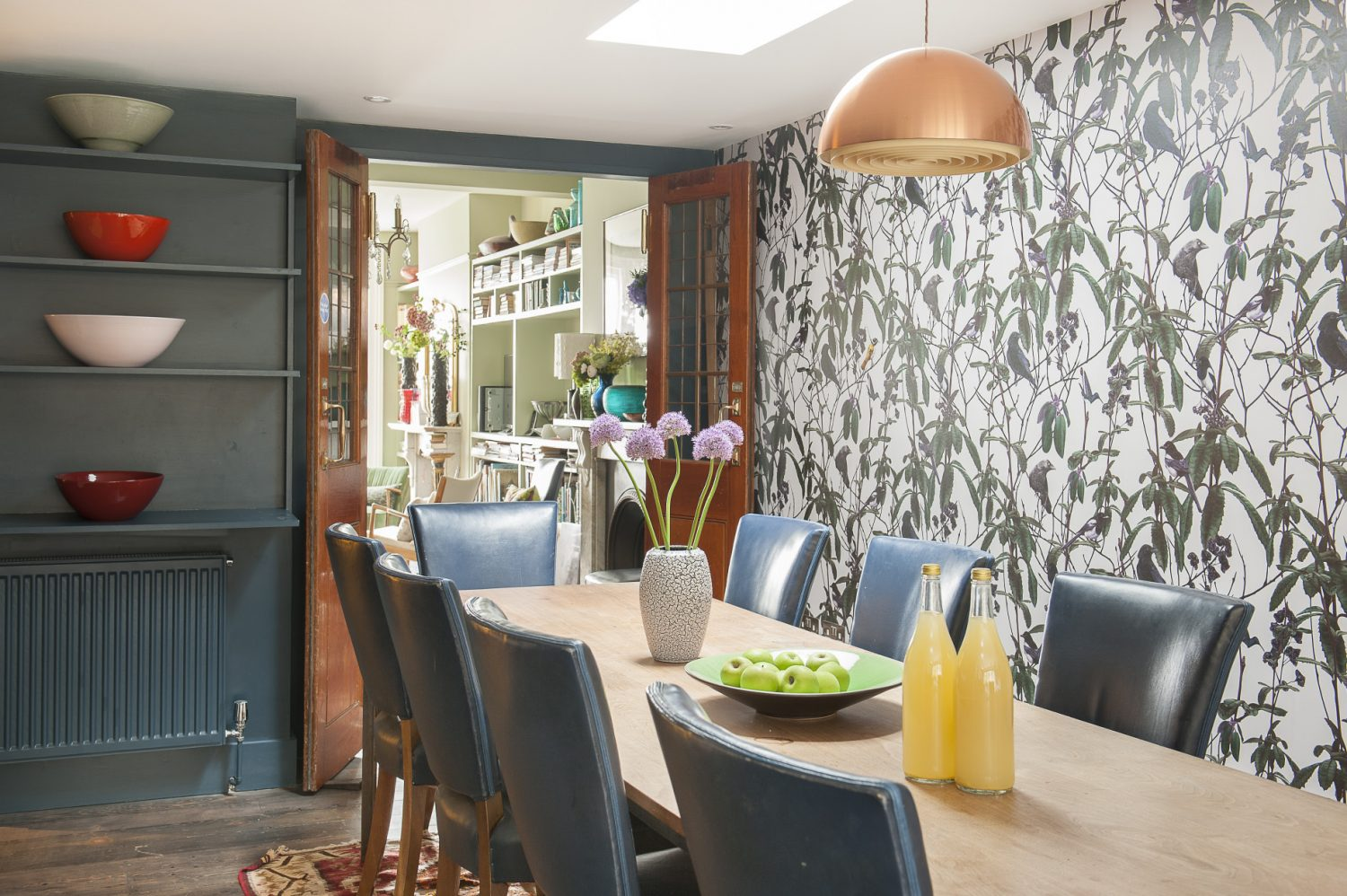 The kitchen-dining area is not a room to hurry through. Along one wall runs a huge refectory table in walnut – originally from the old British Library Reading Room