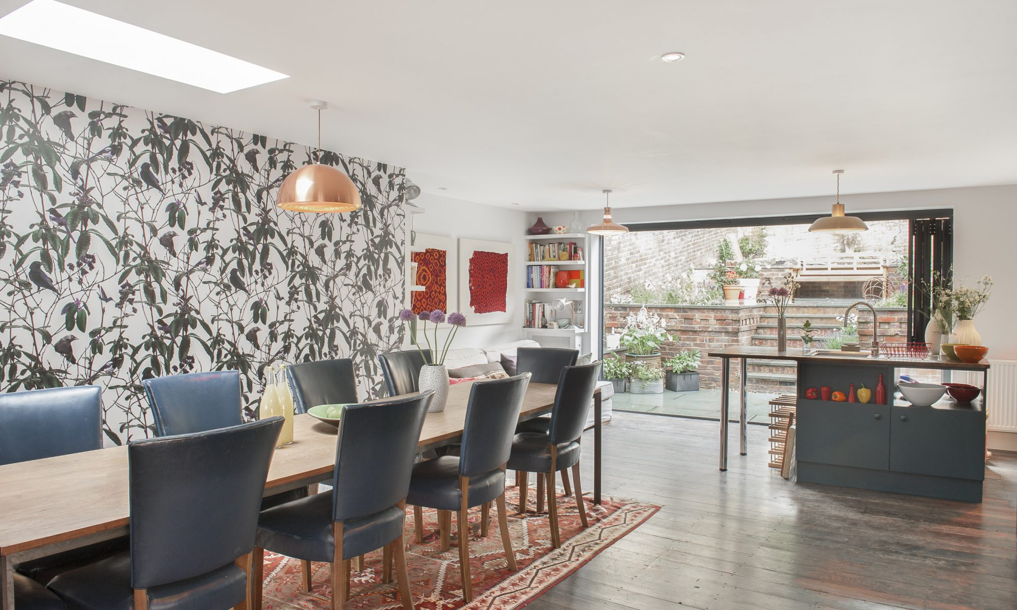 With inspiring views looking out to sea and glorious opened-up spaces within, Ginny and MJ have made a commanding terrace house in Hastings as harmonious as the choirs they run