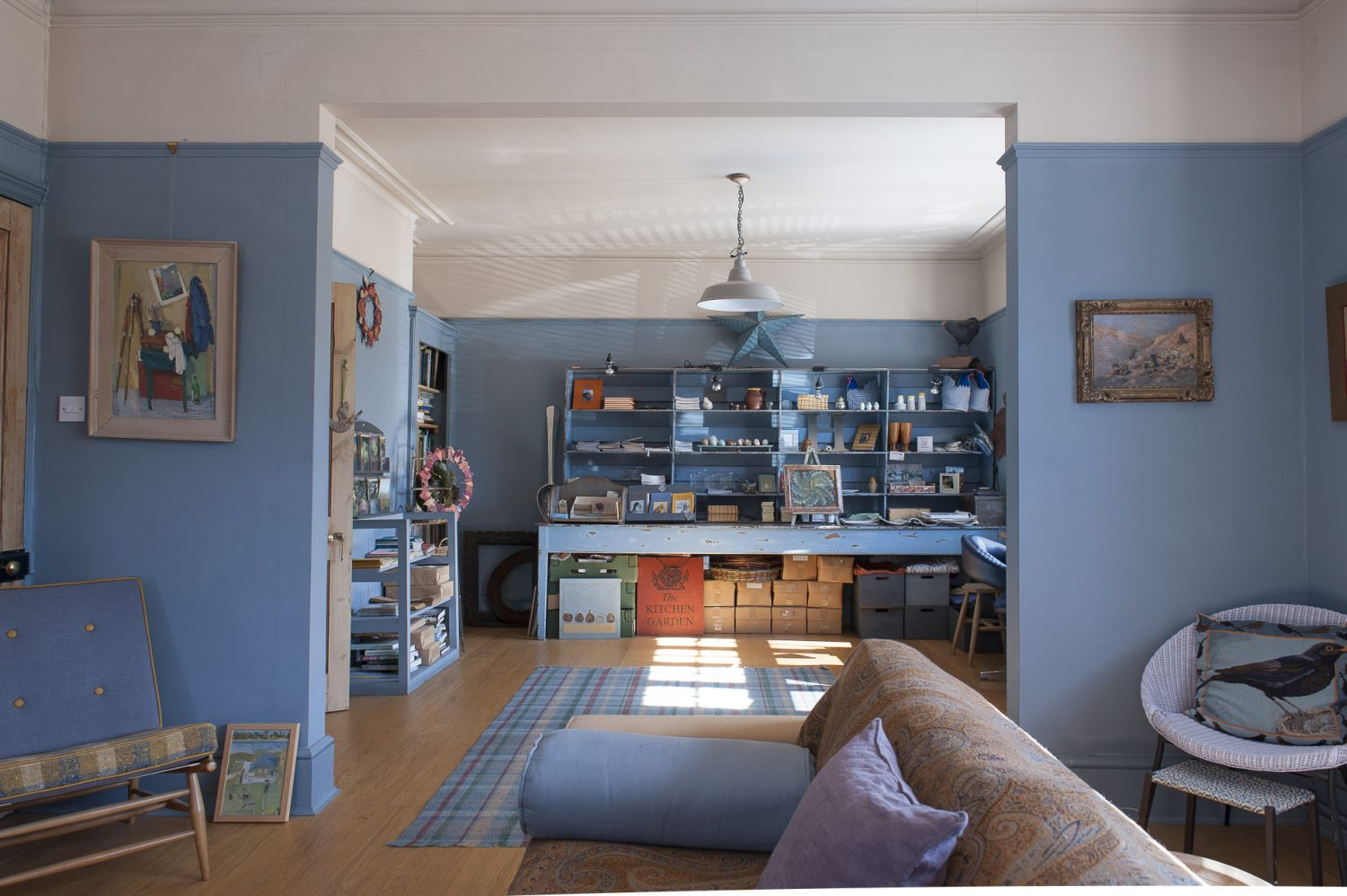 The open-plan living room and office have original Arts and Crafts windows which capture the morning sun