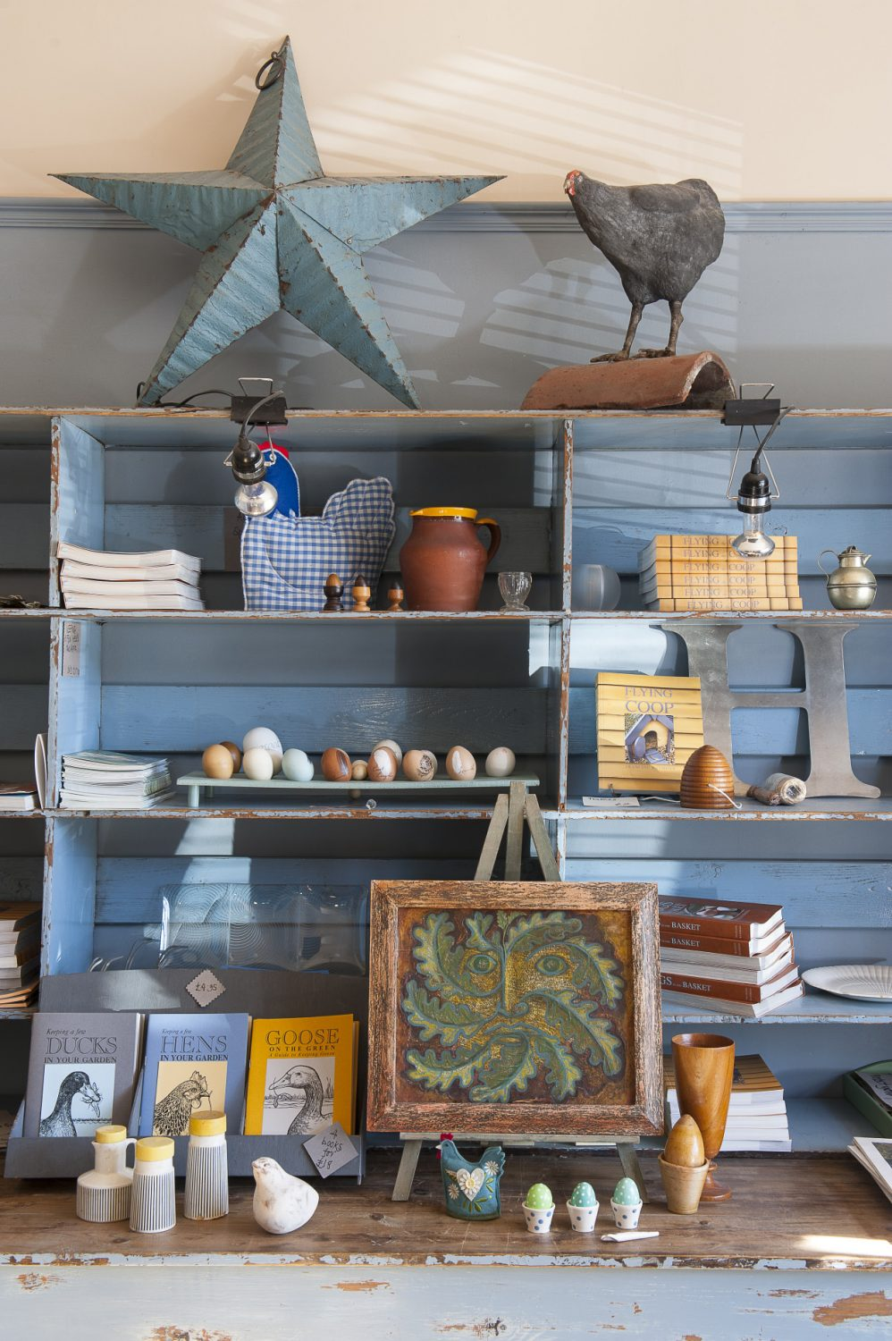 The office area turns into a pop-up shop before Christmas and in mid summer when Francine opens up her house and garden. A vast shelving unit, transported from Suffolk, displays Francine's range of books as well as decorative items and inspiring art and craft