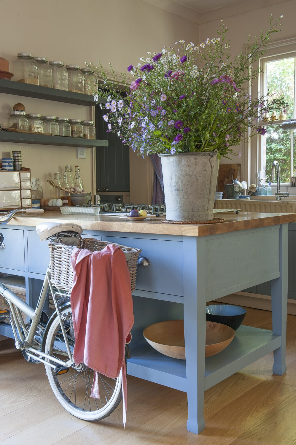 Francine's much-loved 1960s bicycle, which she bought locally, is perfect for nipping to the shops. It lives in the kitchen, propped up against a kitchen unit built by Francine's son Jacques