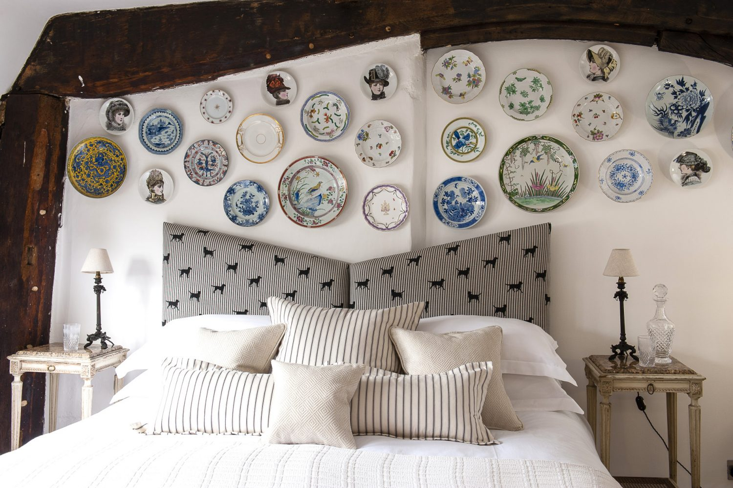 Using his grandmother's Herend pieces as a start, Matthew has gathered a superb collection of porcelain plates which now hang above the upholstered bedhead in Labrador