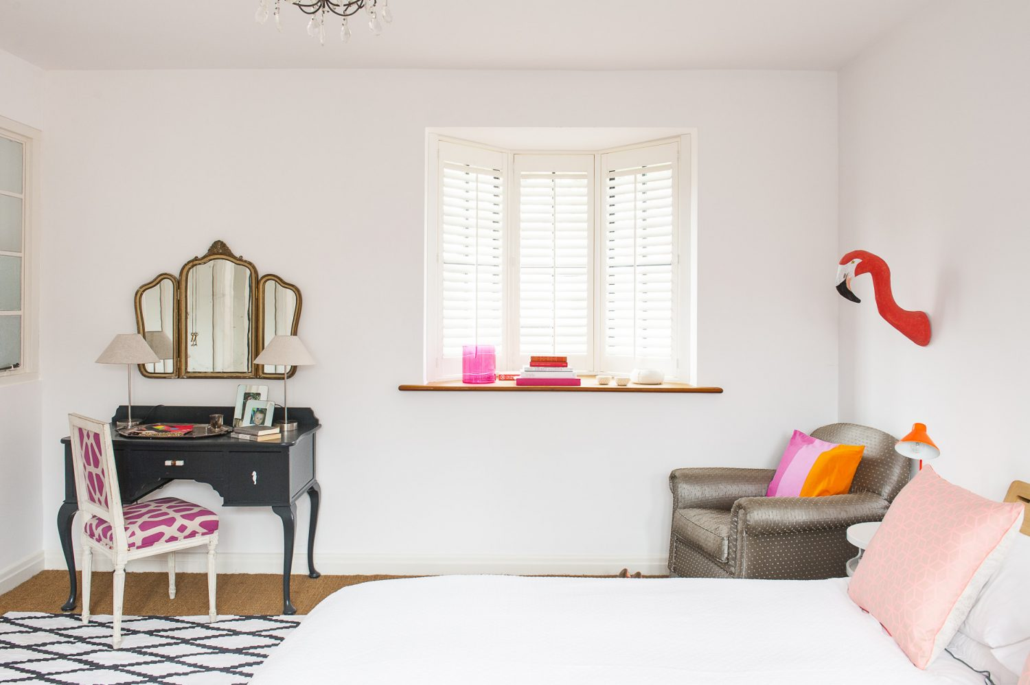Bright dashes of colour and touches of humour, such as the flamingo's head protruding from the wall, prevent the rooms feeling at all austere – despite the liberal use of white paint on the walls