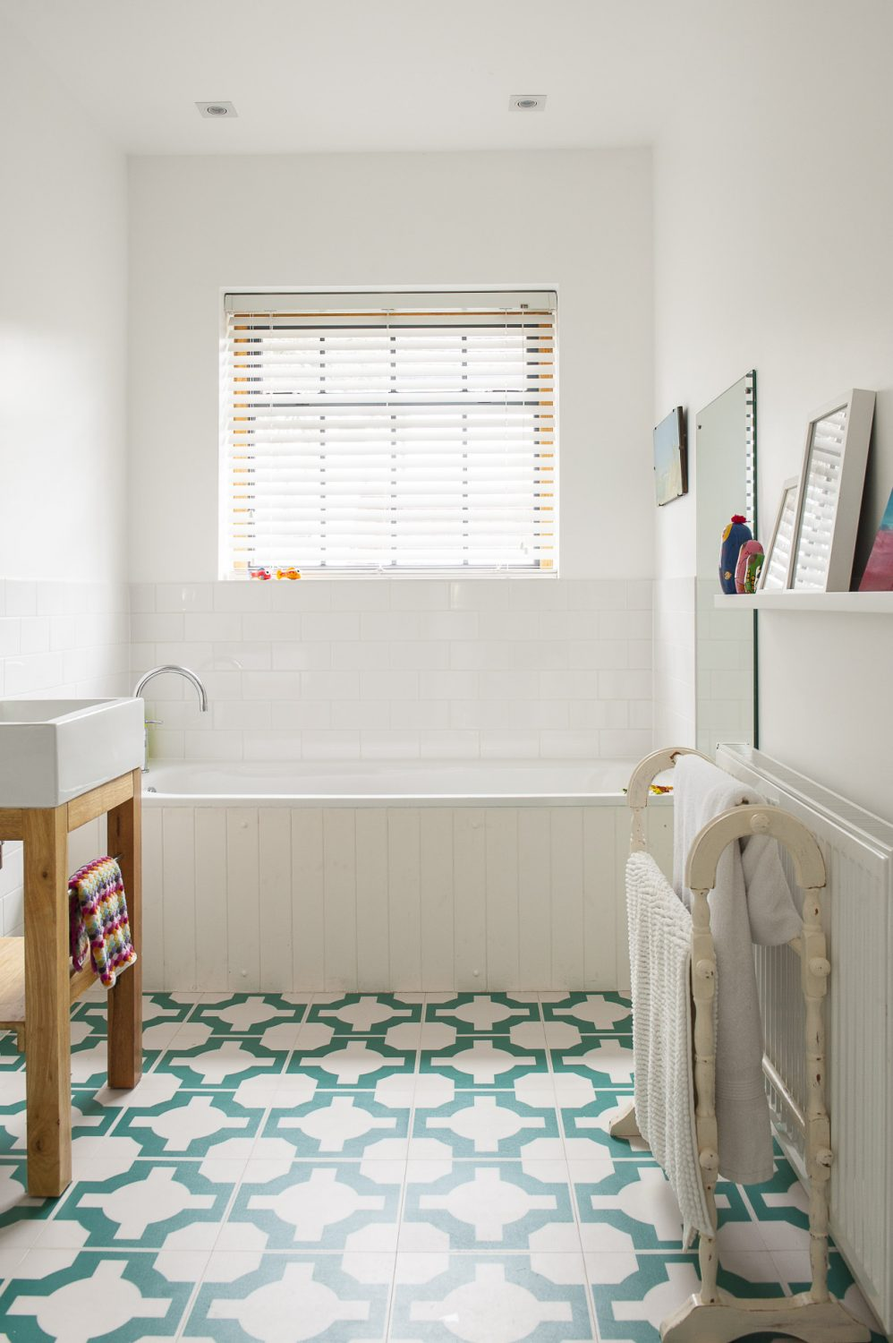 The simple bathroom manages to be both stylish and functional