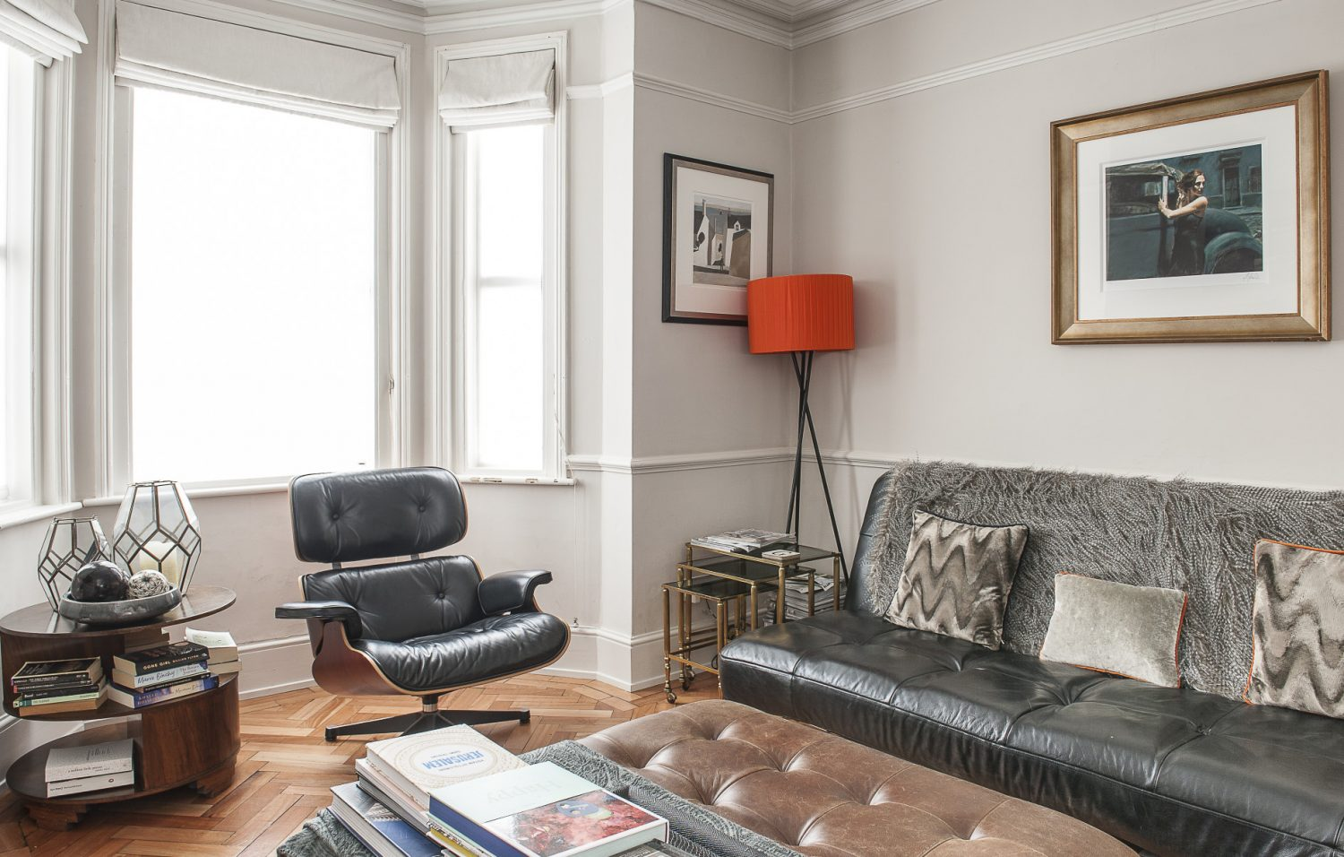 Justine describes the living room, which is at the front of the house, as a 'work in progress'. Even so, the subtle paint scheme and signature pieces of furniture, including a Charles Eames chair and a Hans Wegner rocker, give it understated style