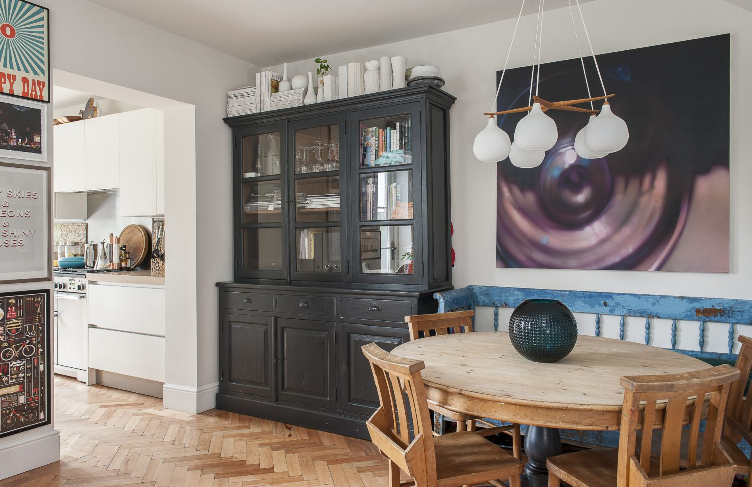 The open-plan kitchen and dining area both feature reclaimed parquet flooring, interconnecting the rooms and making the whole area feel light and bright. The kitchen, which now opens directly on to the garden was once dark and cluttered and accessed via a dining room