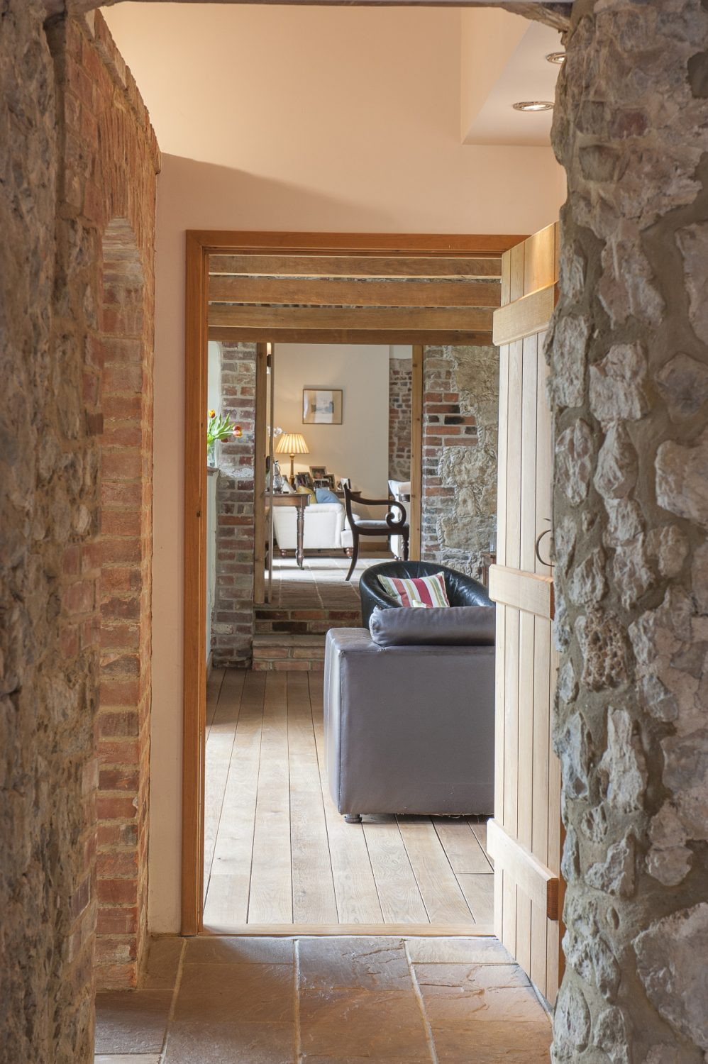 Perpendicular to the kitchen, a short corridor leads to the sitting and dining room