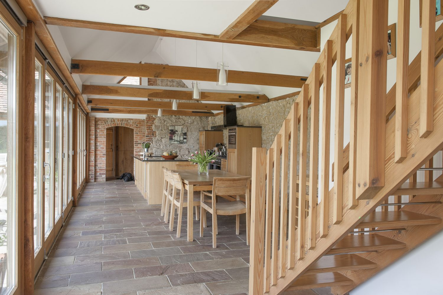A wonderful vaulted kitchen/dining room lies at the heart of the house. Three walls are of exposed ragstone and the fourth composed of three sets of bi-folding doors that open into the garden