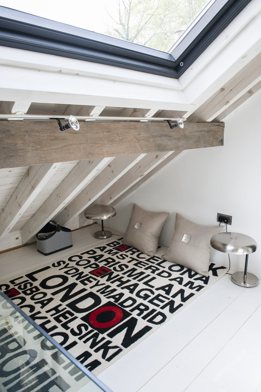 The couple have carefully considered every inch of space – a secluded area for relaxation nestles snugly in the eaves at the top of the house