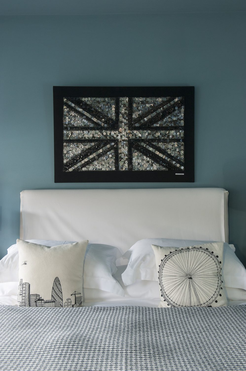 An Ann Carrington original, this time of a Union Jack, hangs above the bed.