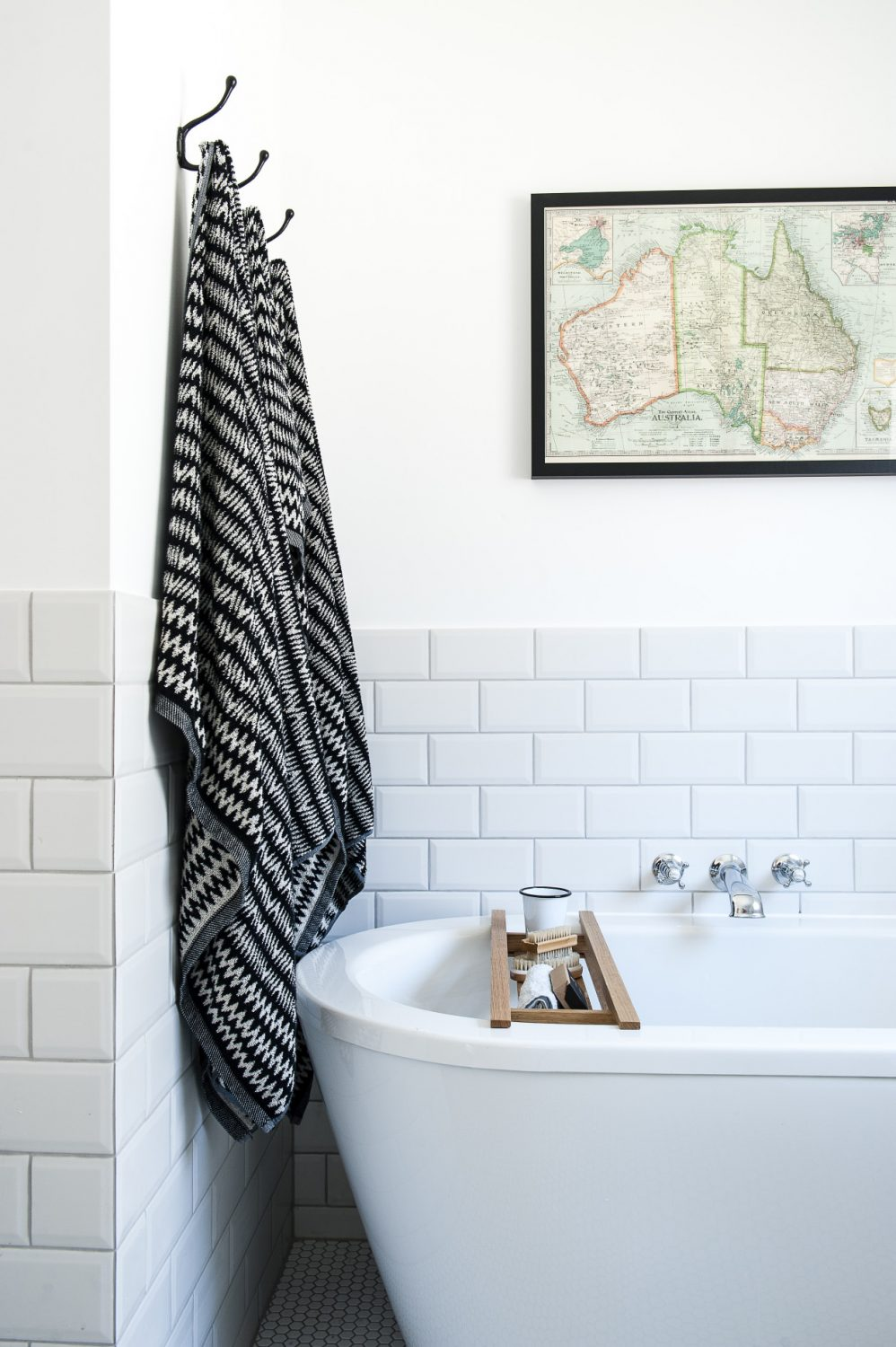 The bath in the ground floor master bathroom is from Patons of Walton and the black and white towels are from House of Fraser. The map of Australia is a piece of wrapping paper from Willow & Stone, which Jenna had framed