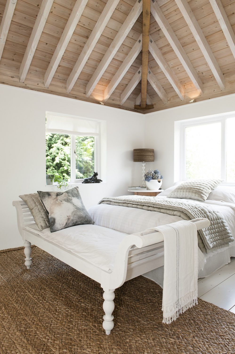 In the principal, vaulted guest room the soaring ceiling timbers have been treated with a lye and soap wash