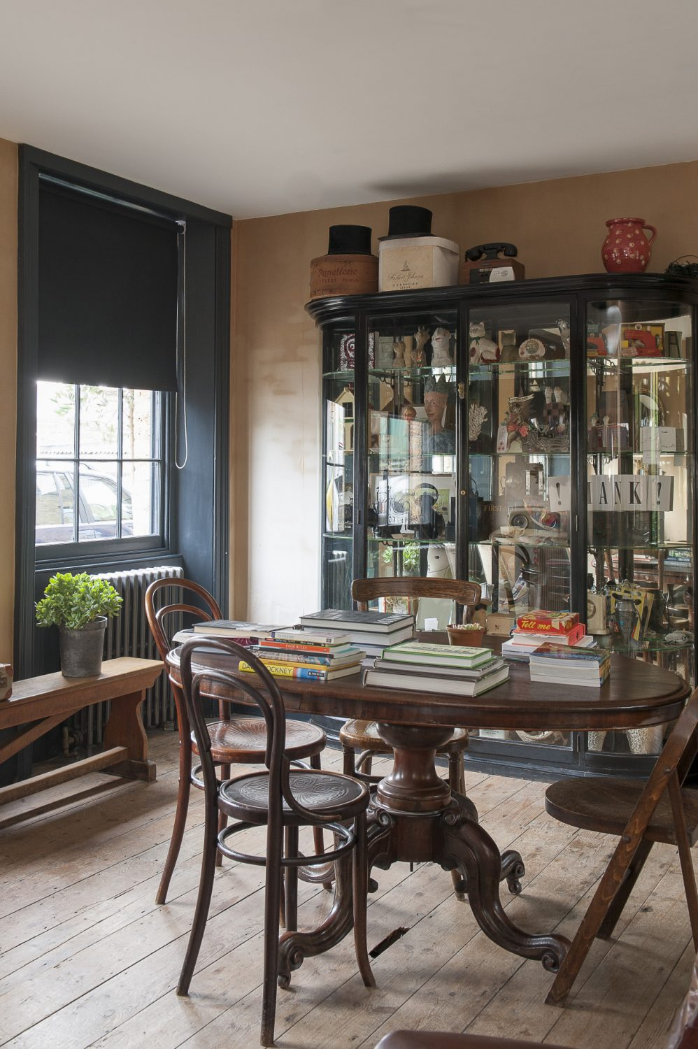Against the wall is a large, glass-fronted 'cupboard of curiosities' which in a way reflects the eclectic contents of the building itself